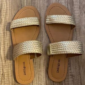 Gold sandals from indigo Rd.